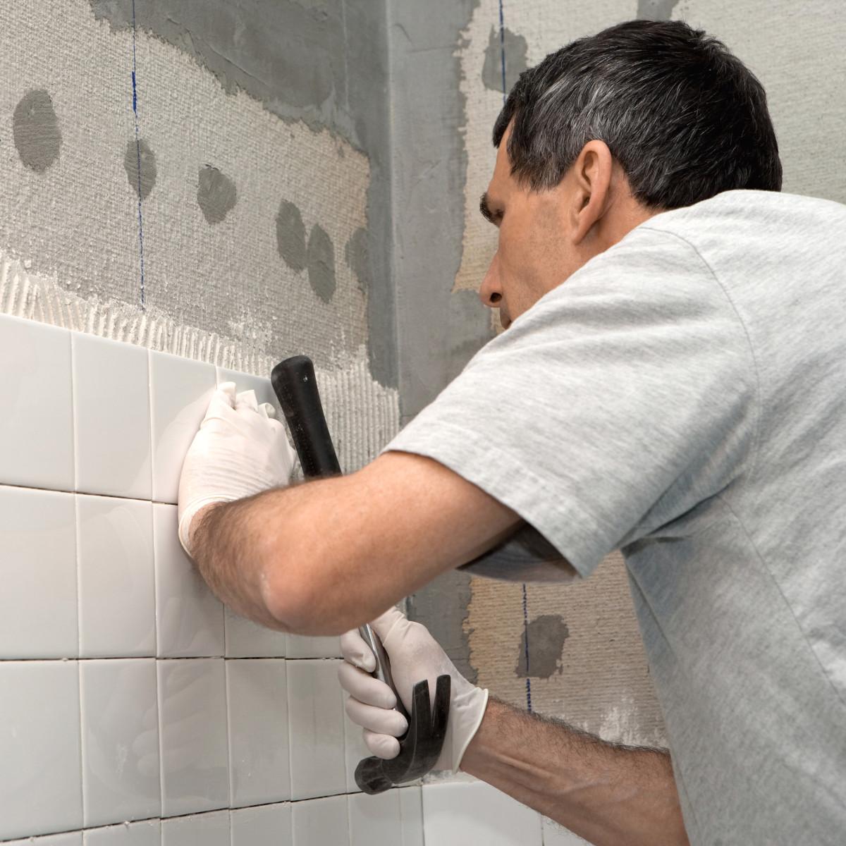 Skills At Work - Man Tiling Shower